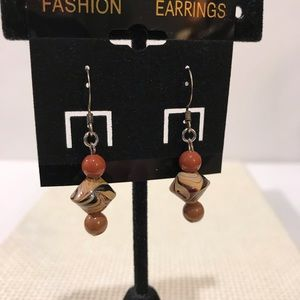 Wood tones pierced earrings and silver.